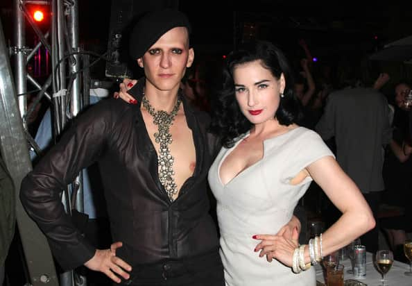Dita Von Teese with Mr Pearl a man wearing corsets