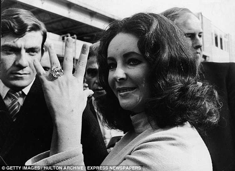 Elizabeth Taylor showing her diamond ring